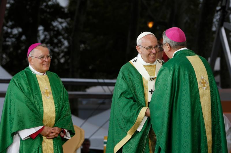 Pope Francis greets Dublin Archbishop Diarmuid Martin during the closing Mass of the World Meeting of Families on Benjamin Franklin Parkway in Philadelphia Sept. 27. The 2108 World Meeting of Families is to be held in Dublin. Looking on is Archbishop Charles J. Chaput of Philadelphia. (CNS photo/Paul Haring) See POPE-FAMILY-MASS Sept. 27, 2015.