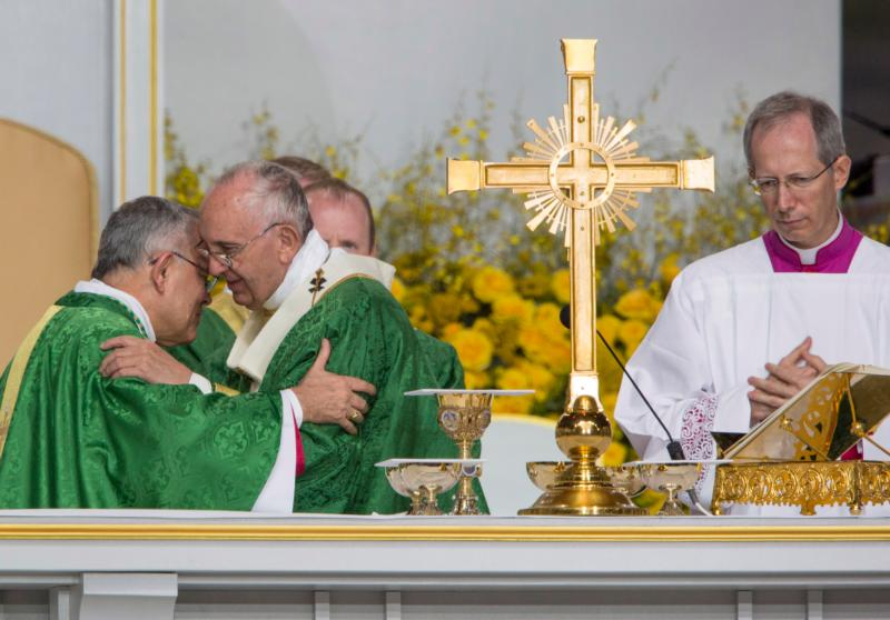Pope Francis exchanges the sign of peace with Archbishop Charles J. Chaput during the closing Mass of the World Meeting of Families on Benjamin Franklin Parkway in Philadelphia Sept. 27. (CNS photo/Rick Musacchio, Tennessee Register) See POPE-FAMILY-MASS Sept. 27, 2015.