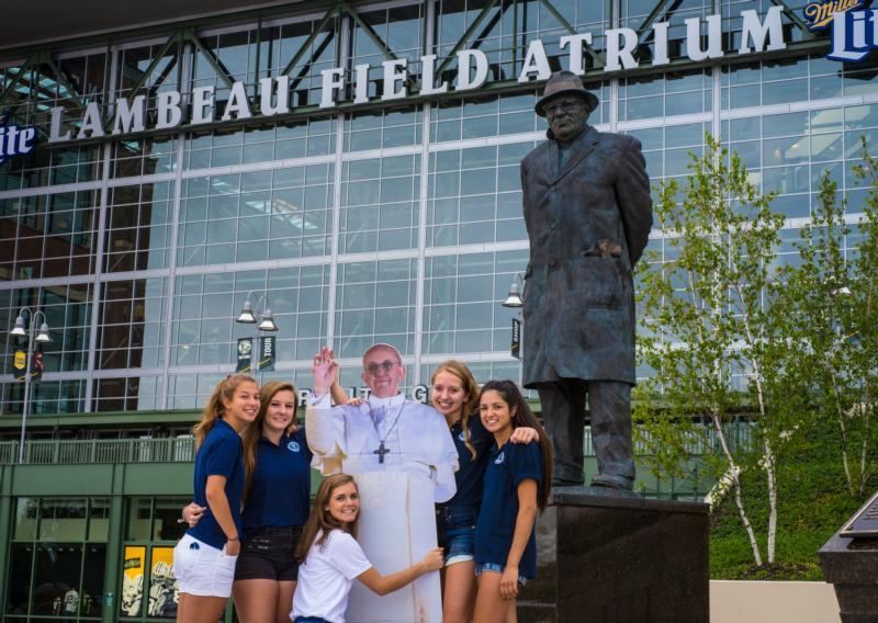 Students from Notre Dame Academy in Green Bay, Wis., are pictured outside of Lambeau Field with a cutout of Pope Francis Sept. 7. Green Bay Mayor Jim Schmitt had hoped that Pope Francis would celebrate a Mass on the Green Bay Packers' playing field as part of his U.S. visit. (CNS photo/Sam Lucero, The Compass)