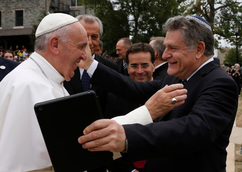 Pope Francis embraces Rabbi Abraham Skorka during a brief stop at St. Joseph's University in Philadelphia Sept. 27. Skorka,   a longtime friend of the pope, co-authored a best-selling book with him about their interfaith dialogue. (CNS photo/Paul Haring) See POPE-PHILLY-UNIVERSITY Sept. 27, 2015.
