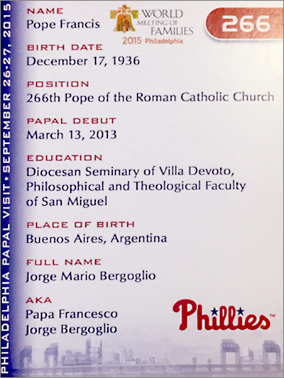 "The back of the keepsake card shows Pope Francis' ""stats."""