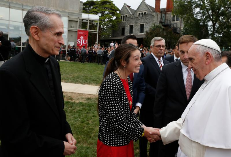"Pope Francis greets a woman during a brief stop at St. Joseph's University in Philadelphia Sept. 27. The pope blessed a sculpture on the campus that commemorates the 50th anniversary of ""Nostra Aetate,"" the Second Vatican Council Declaration on the Relationship of the Church to Non-Christian Religions. (CNS photo/Paul Haring)"