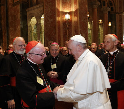Pope Francis greets Cardinal James Stafford during a prayer and meeting with U.S. bishops in the Cathedral of St. Matthew the Apostle in Washington Sept. 23. (CNS photo/Paul Haring)