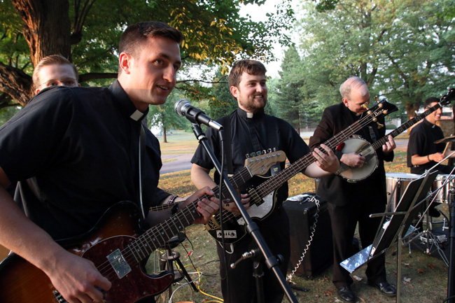 Seminarians Michael Plona, left, and John Wachowicz, center, of the Diocese of Rockville Centre, N.Y. prepare to perform with fellow rock band members of St. Joseph's Seminary in Yonkers, N.Y., during a barbecue Sept. 2. Ninety-two men are studying for the priesthood at the seminary in 2015-2016. (CNS photo/Gregory A. Shemitz)