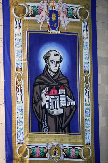 A tapestry featuring an image of Blessed Junipero Serra hangs outside the Basilica of the National Shrine of the Immaculate Conception before Pope Francis arrives for Mass and the canonization of the Spanish missionary Sept. 23 in Washington. (CNS photo/Bob Roller)