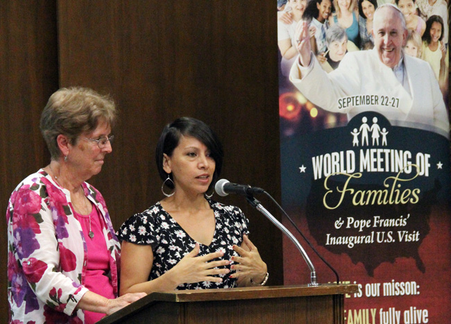 Rosa Murcia-Garcia (right), originally from Guatemala, speaks about her journey to the United States Sept 1 at the Archdiocesan Pastoral Center in Philadelphia. She now helps immigrants in her work on the staff of the Sisters of St. Joseph Welcome Center in the city's Kensington section. At left is Sister of St. Joseph Connie Trainor, director of the center. (Photo by Sarah Webb)