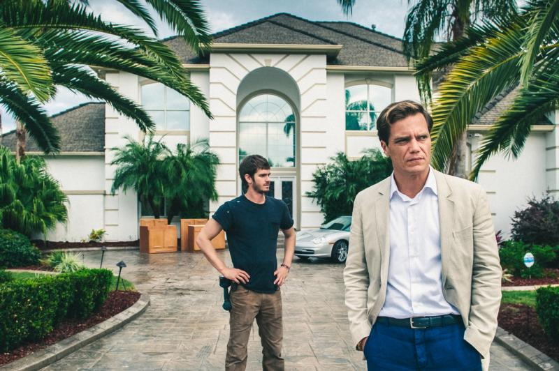 "Andrew Garfield and Michael Shannon star in a scene from the movie ""99 Homes."" (CNS photo/Hooman Bahrani, Broad Green Pictures)"