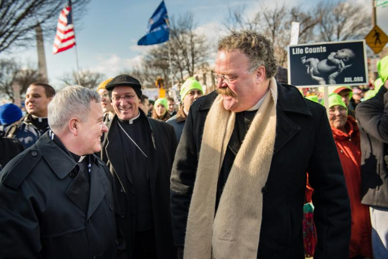 St. Louis Archbishop Robert J. Carlson and the Rev. Matthew C. Harrison, president of The Lutheran Church-Missouri Synod, walk side by side Jan.22 during the March for Life in Washington. (CNS photo/Erik M. Lunsford, courtesy The Lutheran Church-Missouri Synod)