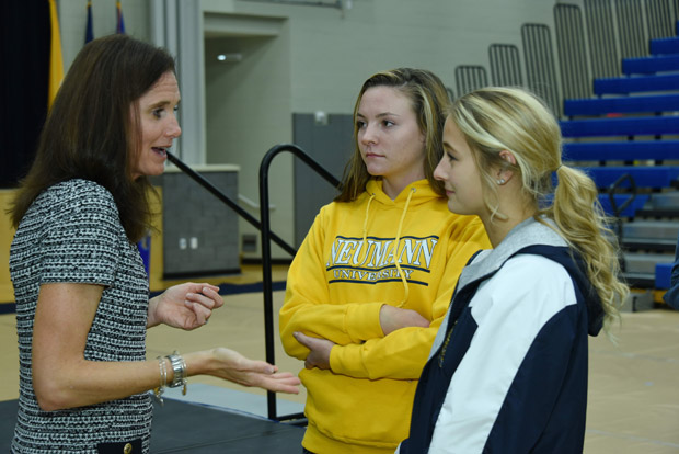 Haley Scott DeMaria (left) speaks with some of the approximately 300 student-athletes at Neumann University, Aston, on Monday, Oct. 19.