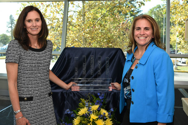Haley Scott DeMaria (left) and Lee DelleMonache, director of the Institute for Sport, Spirituality and Character Development, stand with the institute's award.