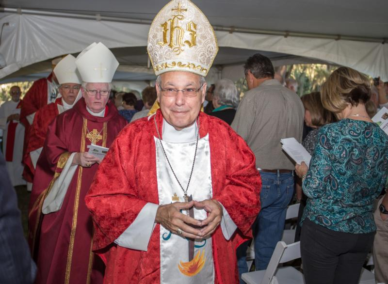 Bishop Felipe Estevez of St. Augustine, Fla., arrives in procession to celebrate Mass near Tallahassee Oct. 12. (CNS photo/Woody Huband, St. Augustine Catholic)