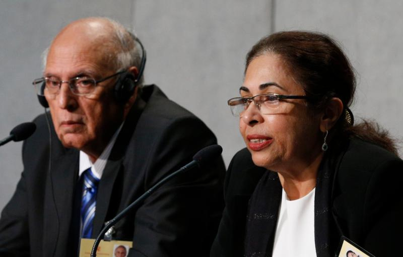 Penny Bajaj, accompanied by her husband Ishwar, speaks during a press briefing after the morning session of the Syond of Bishops on the family at the Vatican Oct. 12. The couple from Mumbai, India, are observers at the synod. (CNS/Paul Haring) See SYNOD-COUPLE-SURPRISES Oct. 12, 2015.