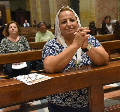 Margaret Injak, 63, a Catholic resident of Jerusalem's Old City, prays Oct. 18 in St. Saviour's Parish near her home. (CNS photo/Debbie Hill)