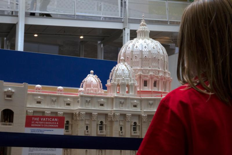 A girl visiting the Franklin Institute Science Museum in Philadelphia Oct. 23 takes a close look at a Lego rendition of the Vatican's St. Peter's Basilica, crafted by Father Bob Simon, pastor of St. Catherine of Siena Parish in Moscow, Pa. Father Simon says his Lego-building hobby has served as an evangelization tool. (CNS photo/Chaz Muth)