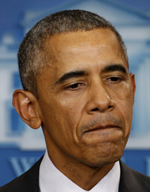 U.S. President Barack Obama looks grim as he speaks about the shootings in Oregon from the White House in Washington Oct. 1. He blamed the gun lobby for blocking gun control legislation. (CNS photo/Kevin Lamarque, Reuters)