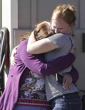 Umpqua Community College alumna Donice Smith, left, is embraced after learning one of her former teachers was killed in Roseburg, Ore., Oct. 1. (CNS photo/Steve Dipaola, Reuters)