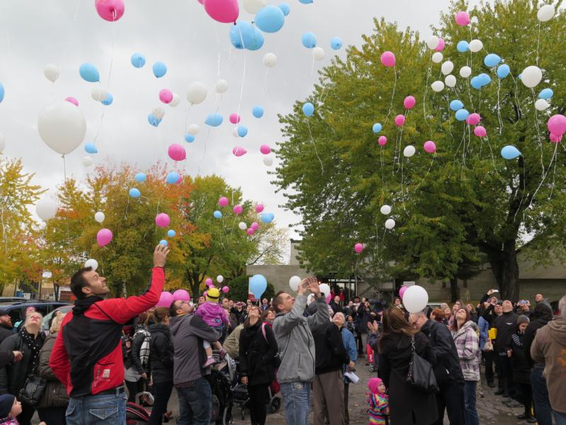 Parents who have lost babies release balloons at St. Cecilia Church in Quebec City for the Feast of the Angels Oct. 17. (CNS photo/Philippe Vaillancourt, Presence)