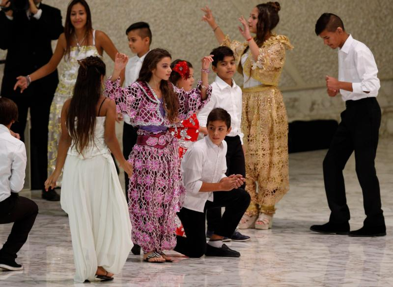 Dancers perform for Pope Francis during an audience with Roma, Sinti and Irish Travelers and other itinerant communities in Paul VI hall at the Vatican Oct. 26. The pope called for an end to centuries of prejudice against Gypsy communities. (CNS photo/Paul Haring)