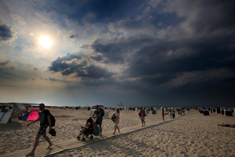 People leave a cloudy beach in Rostock-Warnemunde, Germany, Aug. 4. Pope Francis said in his morning homily Oct. 23 that God made people free so they can fearlessly adapt to the changing times while remaining true to Christ(CNS photo/Bernd Wuestneck, EPA)
