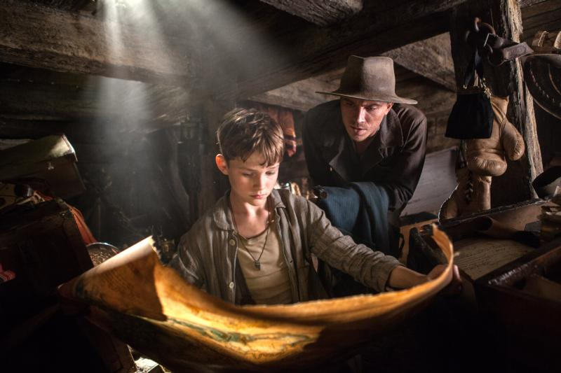 "Levi Miller and Garrett Hedlund star in a scene from the movie ""Pan."" (CNS photo/Warner Bros.)"