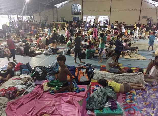 Residents stay at a Manila public school being used as a temporary shelter Oct. 19, after Typhoon Koppu swept across the northern Philippines. (CNS photo/Jay Enero, Reuters)