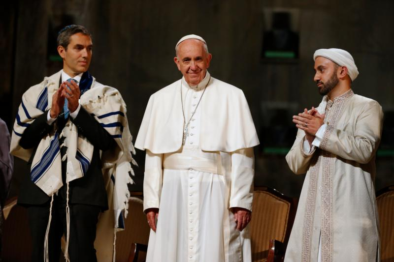 Pope Francis stands with Rabbi Elliot J. Cosgrove (left) and Iman Khalid Latif (right) at a interreligious gathering at the the 9/11 Memorial Museum in New York Sept. 25. (CNS photo/Jin Lee, pool)