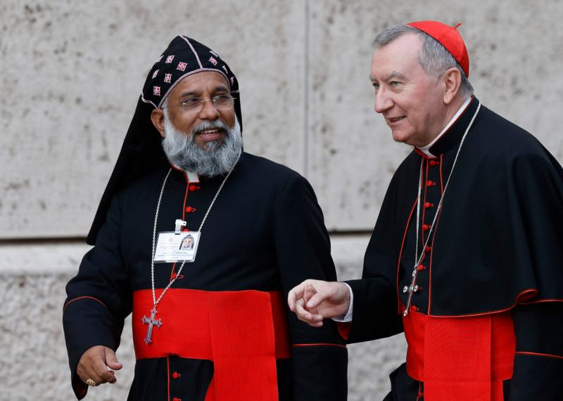 Cardinals Baselios Cleemis Thottunkal of Trivandrum, India, major archbishop of the Syro-Malankara Catholic Church and Pietro Parolin, Vatican secretary of state; arrive for the morning session of the Synod of Bishops on the family at the Vatican Oct. 6. (CNS photo/Paul Haring)