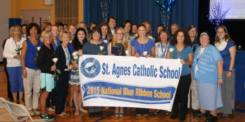 The faculty and staff of St. Agnes celebrate the good news of their designation as a Blue Ribbon school.