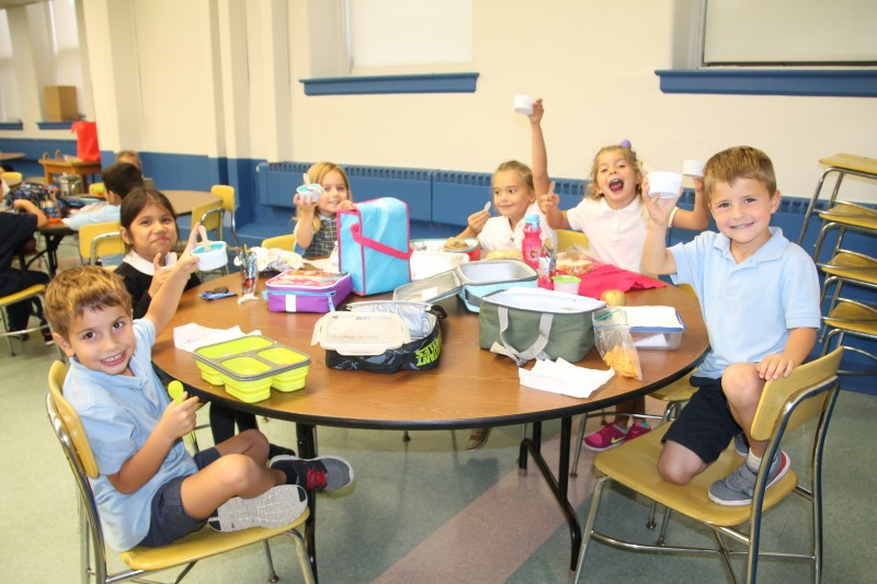 The young students of St. Agnes enjoy blue water ice to celebrate their school's 2015 Blue Ribbon award.