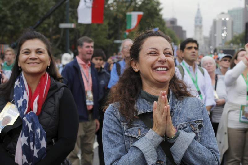 A woman reacts to Pope Francis' final words during the closing Mass of the World Meeting of Families on the Benjamin Franklin Parkway in Philadelphia Sept. 27. (CNS photo/Brian Snyder, Reuters)