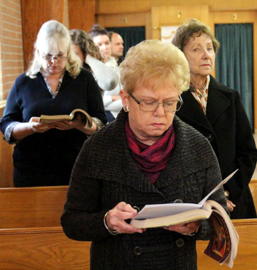 Kathy Holmes reads along with the Gospel