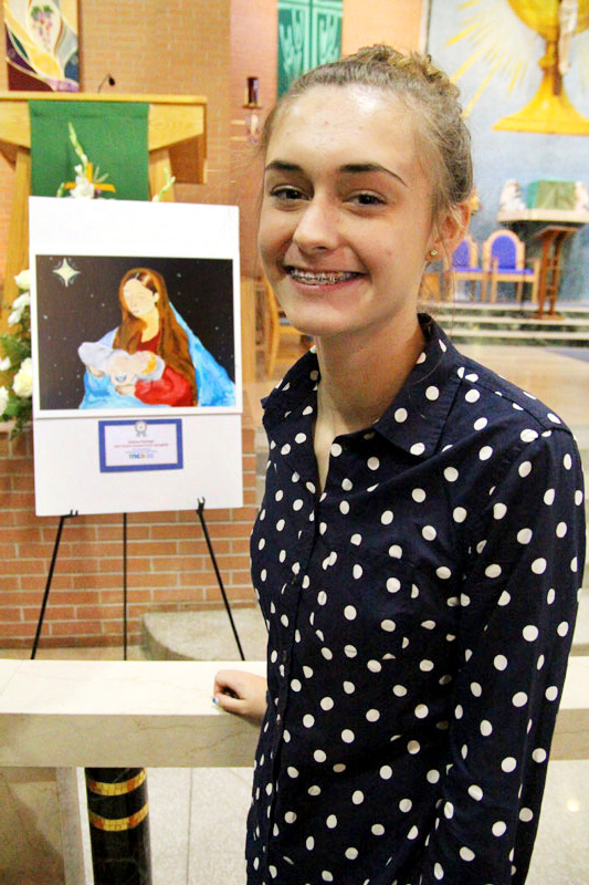 Julianna Kissinger, national winner of Missionary Childhood Association 2014-15 Christmas Coloring Contest, from St. Francis of Assisi School in Springfield, Delware County poses with her winning artwork.