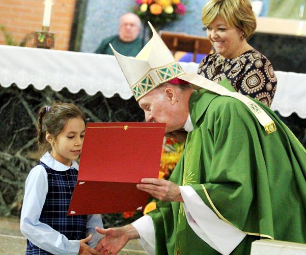 Maria del Mar Zuniga-Stanton from Regina Coeli Academy in Abington receives her Archdiocesan award from Bishop Fitzgerald.