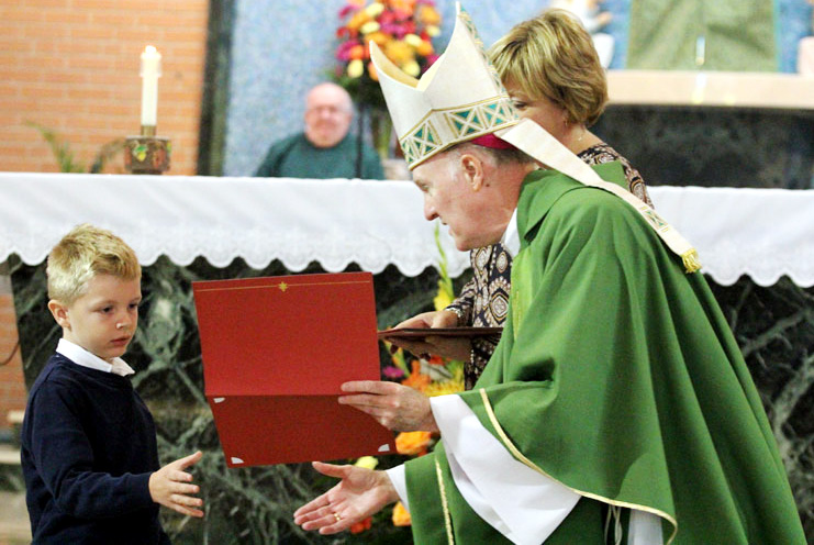 Andrew Huff from St Peter the Apostle School in Philadelphia receives his Archdiocesan award from Bishop Fitzgerald.