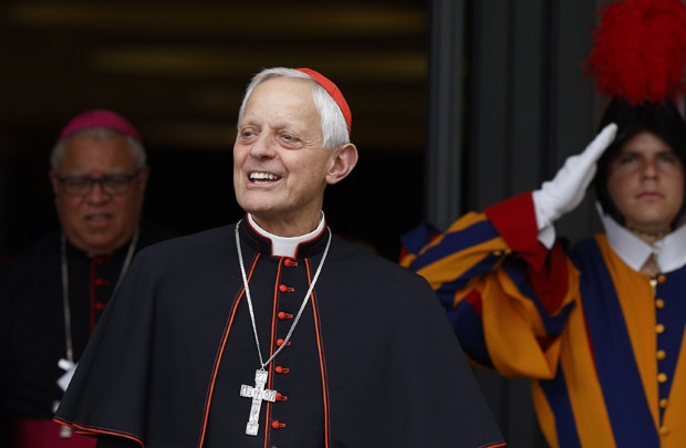 Cardinal Donald W. Wuerl of Washington leaves a session of the Synod of Bishops on the family at the Vatican Oct. 6. (CNS photo/Paul Haring)