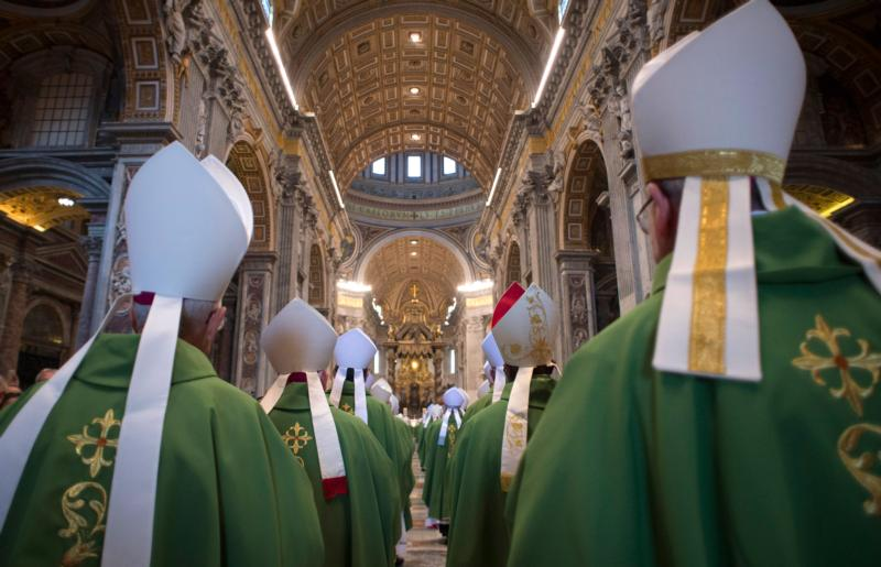 Bishops arrive in procession for the opening Mass of the Synod of Bishops on the family in St. Peter's Basilica at the Vatican Oct. 4. (CNS photo/L'Osservatore Romano, handout)
