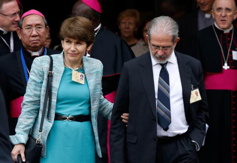 "Ketty and Pedro De Rezende of Brazil leave a session of the Synod of Bishops on the family at the Vatican Oct. 9. The couple, who are observers at the synod, spoke at an Oct. 12 Vatican press briefing at which Pedro said press coverage ""many, many times"" does not reflect the experience within the synod. (CNS/Paul Haring) See SYNOD-COUPLE-SURPRISES Oct. 12, 2015."