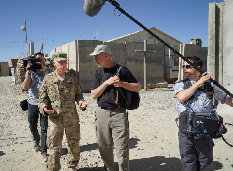 "This production photo taken in 2014 on location in Afghanistan shows cameraman Nathan DeWild, rear left, Father Paul Hurley, senior military chaplain for all U.S. forces, writer-director Martin Doblmeier and soundman Jeremy Zunk. The crew was on a shoot for the public television documentary ""Chaplains. (CNS photo/courtesy Martin Doblmeier)"