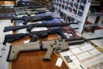 """Guns for sale are displayed in Roseburg Gun Shop in Roseburg, Ore., Oct. 3. Archbishop Blase J. Cupich of Chicago, saying it is time to """"take meaningful and swift action to address violence in our society,"""" called for stricter gun control laws in Illinois and around the nation. (CNS photo/Lucy Nicholson, Reuters)"""