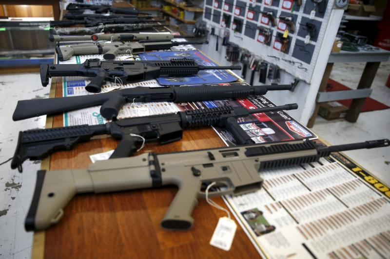 "Guns for sale are displayed in Roseburg Gun Shop in Roseburg, Ore., Oct. 3. Archbishop Blase J. Cupich of Chicago, saying it is time to ""take meaningful and swift action to address violence in our society,"" called for stricter gun control laws in Illinois and around the nation. (CNS photo/Lucy Nicholson, Reuters)"