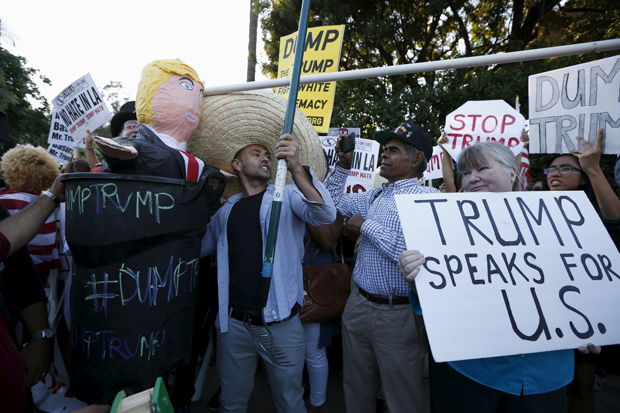 Opponents and supporters of Republican presidential candidate Donald Trump demonstrate outside a Los Angeles hotel July 10. (CNS photo/Lucy Nicholson, Reuters)