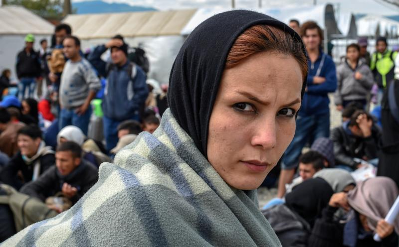 A migrant woman waits at the transit camp near Gevgelija, Macedonia, Sept. 29. (CNS photo/Georgi Licovski, EPA)