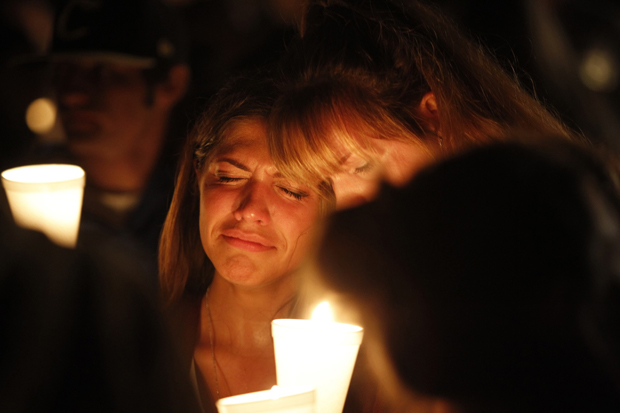 Women console one another during a candlelit vigil following a mass shooting at Umpqua Community College in Roseburg, Ore., Oct. 1. (CNS photo/Steve Dipaola, Reuters)