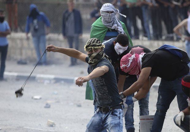 Palestinian protesters clash with Israeli soldiers in Bethlehem, West Bank, Oct. 6. Violence in Israel and the West Bank has increased in October. (CNS photo/Abed Al Haslhamoun, EPA)