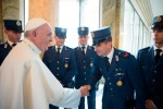 Pope Francis greets Vatican police officers after celebrating a Mass for them at the Vatican Oct. 3. The Vatican police force, known as the gendarmes, work with the Swiss Guard to protect the pope and provide security at the Vatican. (CNS/Paul Haring)
