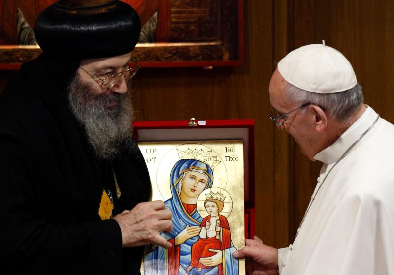 Pope Francis accepts an icon of Mary and the Christ Child from Coptic Orthodox Metropolitan Bishoy of Damiette, Kafr El-Sheikh, and Bararya, all in Egypt, before a session of the Synod of Bishops on the family at the Vatican Oct. 15. (CNS photo/Paul Haring)