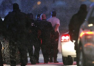 A suspect is taken into custody Nov. 27 outside a Planned Parenthood clinic in Colorado Springs, Colo. Police say Robert Lewis Dear killed three people during the shooting rampage and hours-long standoff at the clinic and was later taken into custody. (CNS photo/Rick Wilking, Reuters)