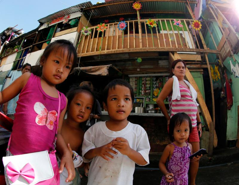 Children are seen next to shanties in Manila, Philippines, Nov. 17. (CNS photo/Francis R. Malasig, EPA)