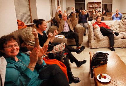 "Franciscan Sister Alicia Torres joins friends and people from the neighborhood for a viewing party at Our Lady of the Mission on Nov. 9. They gathered to watch Sister Alicia compete and win $10,000 on a Thanksgiving episode of the Food Network's ""Chopped."" She says the money will go to feed the poor in the community. (Karen Callaway/Catholic New World photo)"