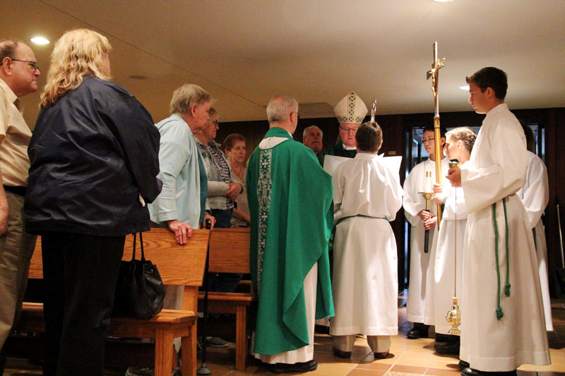 Bishop Michael Fitzgerald hands over the keys of the church to Fr Davis